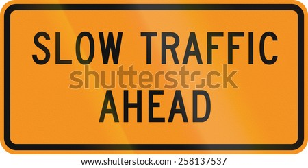 US traffic warning sign: Slow traffic ahead. - stock photo