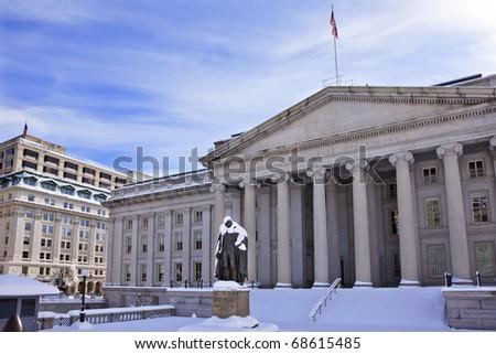 US Treasury Albert Gallatin Statue After Snowstorm Winter Washington DC - stock photo