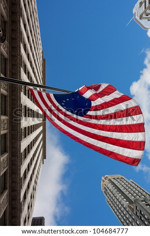 US variant Betsy Ross flag in Chicago and sky scrapers - stock photo