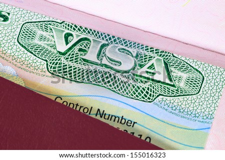 US visa in a passport macro - stock photo