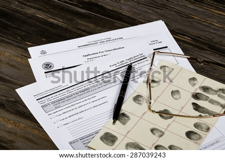 USA America Citizenship Application with glasses. Public documents and studio props. - stock photo