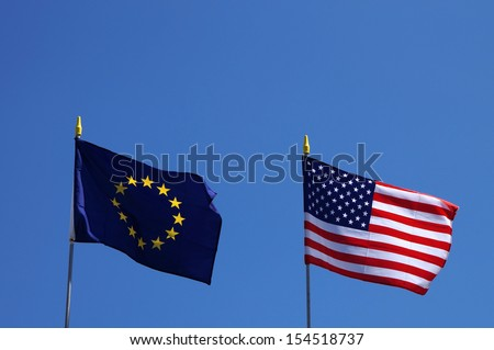 USA and EU flags next to each other waving in the wind - stock photo