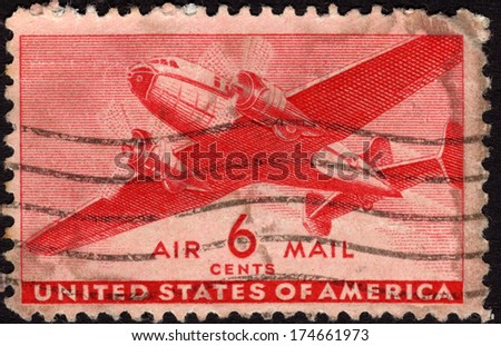 USA - CA. 1943: United States postage stamp in the value of 6 cents used for overseas air mail deliveries showing a vintage transport plane in mid-air and the print Air Mail - stock photo