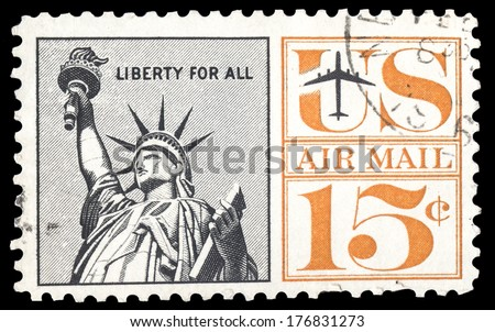USA-CIRCA 1961: A 15 cent United States Airmail postage stamp shows image of The Statue of Liberty, circa 1961. - stock photo