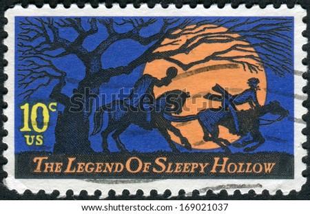 USA - CIRCA 1974: A postage stamp printed in USA, Legend of Sleepy Hollow, by Washington Irving. Design features Headless Horseman pursuing Ichabod Crane, circa 1974 - stock photo