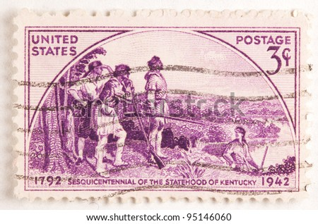 USA - CIRCA 1942: A stamp printed by USA shows explorers entering the state of Kentucky for its Sesquicentennial, circa 1942 - stock photo