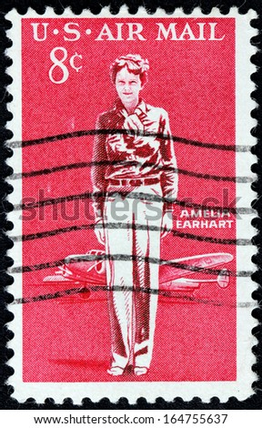 USA - CIRCA 1963: A stamp printed by USA shows image portrait of an American aviation pioneer and author Amelia Earhart, circa 1963. - stock photo