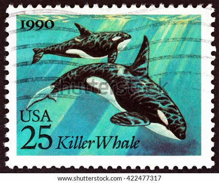 """USA - CIRCA 1990: A stamp printed in USA from the """"Marine Mammals """" issue shows Killer Whales (Orcinus orca), circa 1990. - stock photo"""
