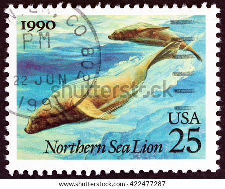 """USA - CIRCA 1990: A stamp printed in USA from the """"Marine Mammals """" issue shows Northern Sea Lions (Eumetopias jubatus), circa 1990. - stock photo"""