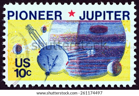 """USA - CIRCA 1975: A stamp printed in USA from the """"Space Issue """" shows Pioneer spacecraft passing Jupiter, circa 1975. - stock photo"""