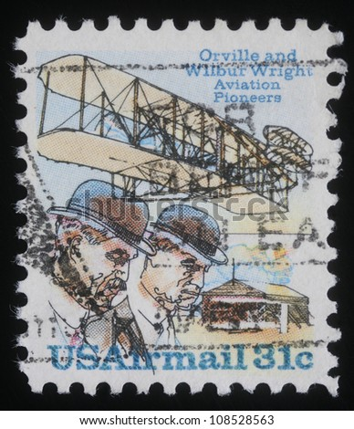 USA - CIRCA 1978: A stamp printed in USA issued for the 75th Anniversary of First Powered Flight showing Wright brothers and Wright Flyer I plane, circa 1978. - stock photo