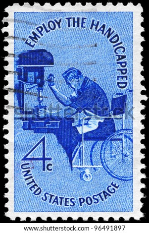 USA - CIRCA 1960: A Stamp printed in USA shows a Man in Wheelchair operating Drill Press, Employ the Handicapped Issue, circa 1960 - stock photo
