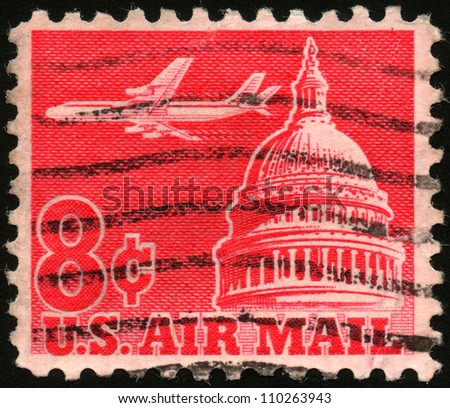 USA - CIRCA 1962: A stamp printed in USA shows an airplane flying across the Senate building, circa 1962 - stock photo