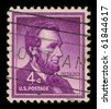 USA - CIRCA 1930: A stamp printed in USA shows image portrait Abraham Lincoln served as the 16th President of the United States from March 1861 until his assassination in April 1865, circa 1930. - stock photo