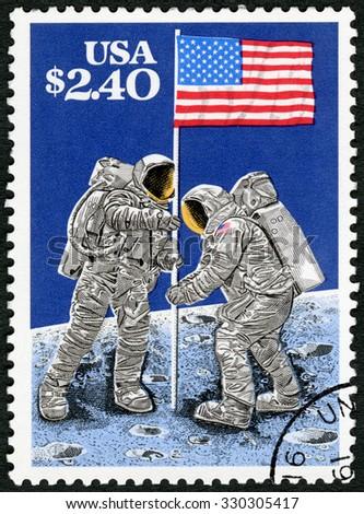 USA - CIRCA 1989: A stamp printed in USA shows Raising Flag on Lunar Surface, July 20, 1969, Moon Landing, 20th Anniversary, circa 1989 - stock photo