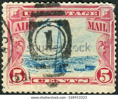 USA - CIRCA 1928: Postage stamps printed in USA, shows Beacon on Sherman Hill, Rocky Mountains and airplane, circa 1928 - stock photo