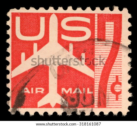 USA - CIRCA 1960: United States postage stamp in the value of 7c used for overseas air mail deliveries showing air mail symbols and the print Air Mail, circa 1960 - stock photo
