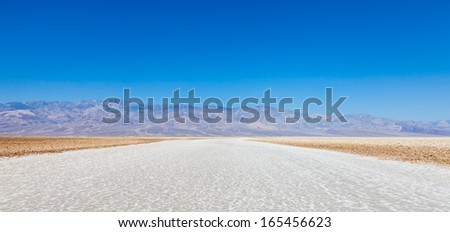 USA, Death Valley. Badwater point: salt road in the middle of the desert - stock photo