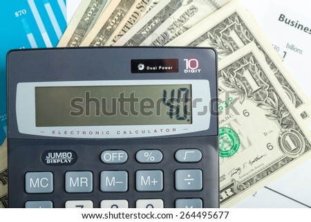 USA dollar money banknotes and calculator, money concept, business workplace - stock photo
