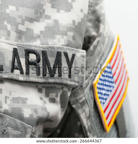 USA flag and U.S. Army patch on solder uniform - stock photo
