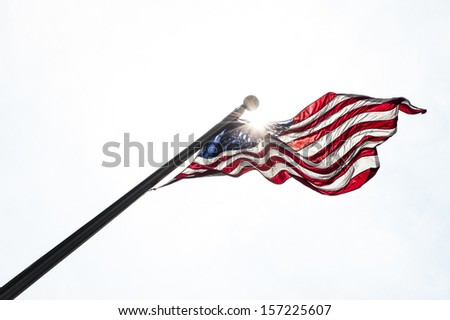 Usa flag in the sky with sun rays - stock photo