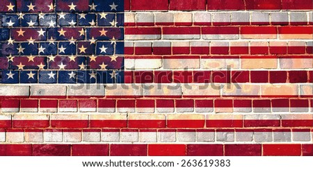 USA flag on a brick wall background - stock photo