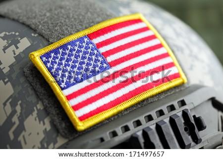 USA flag on military helmet close-up, shallow DOF - stock photo