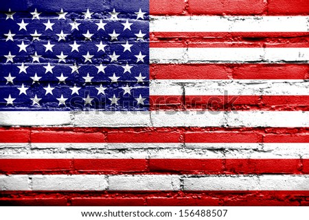 USA Flag painted on old brick wall - stock photo