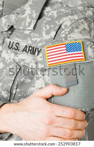 USA flag shoulder patch on solder's uniform - stock photo