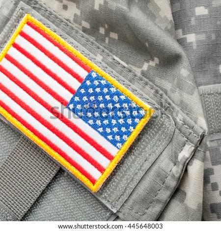USA flag shoulder patch on solder's uniform - close up shot - stock photo