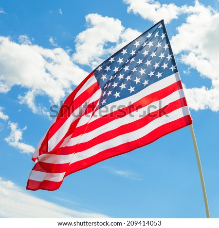 USA flag waving on blue sky background - outdoors shoot - 1 to 1 ratio - stock photo