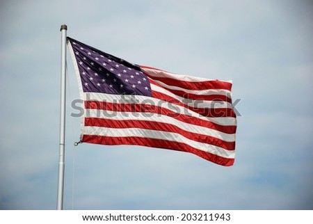 USA flags on a cloudy day - stock photo