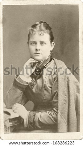 USA - ILLINOIS - CIRCA 1870 - A vintage Cartes de visite photo of a young girl dressed in a Victorian style dress and shawl. She is sitting in a chair. A photo from the Civil War era. CIRCA 1870 - stock photo