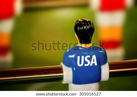 USA National Jersey on Vintage Foosball, Table Soccer or Football Kicker Game, Selective Focus, Retro Tone Effect - stock photo