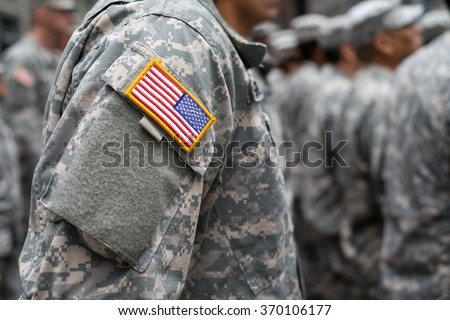 USA patch flag on soldiers arm - stock photo