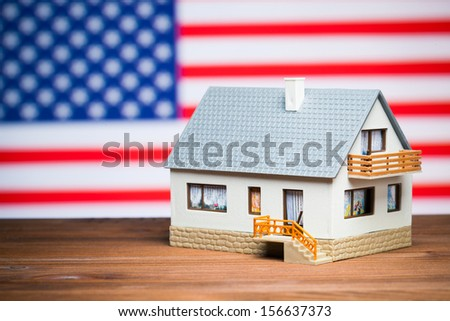 usa realty concept: house against american flag - stock photo