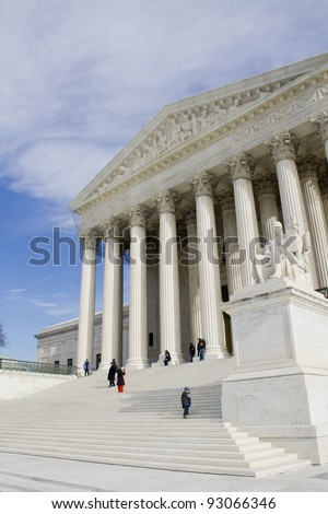 USA Supreme Court building in Washington, D.C. with a cloudy sky background. - stock photo
