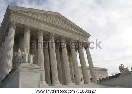 USA Supreme Court building in Washington, DC with a cloudy sky background. - stock photo