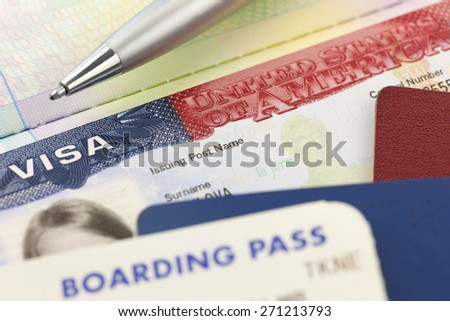 USA Visa, passports, boarding pass and pen - foreign travel background - stock photo