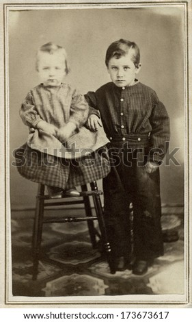 USA - WISCONSIN - CIRCA 1865 - A vintage Cartes de visite photo of a little boy and baby girl. The boy is standing and the baby is sitting. A photo from the Civil War Victorian era. CIRCA 1865 - stock photo