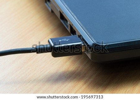 USB cable connect with Laptop Computer - stock photo