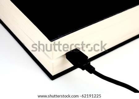 USB cable connected to a book - stock photo