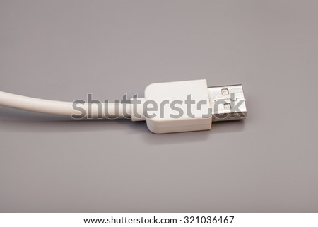 USB cable isolated on gray background - stock photo