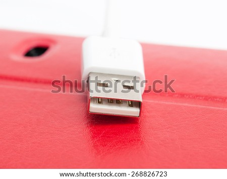USB cable. Macro with shallow dof. - stock photo