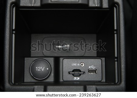 USB dock with charging cable on a car - stock photo