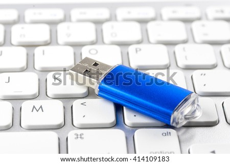 USB Flash drive on computer laptop keyboard - stock photo