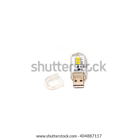 USB memory stick in transparent body isolated on white background - stock photo
