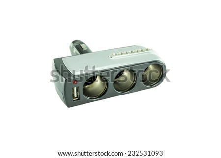 USB triple socket adapter converter plug with charging cable on a car - stock photo