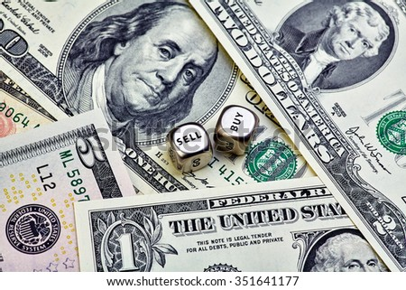 USD banknotes and dices cubes. Selective focus - stock photo
