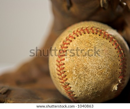 Used Ball and Glove - stock photo